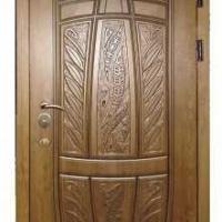 Металлическая эксклюзивная дверь с массивом дуба с 2-х сторон